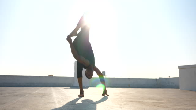 ms male dancer balancing upside down while performing on rooftop - tights stock videos & royalty-free footage