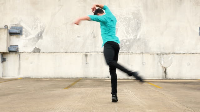 ms ts male dancer dancing on rooftop of building - modern dancing stock videos & royalty-free footage