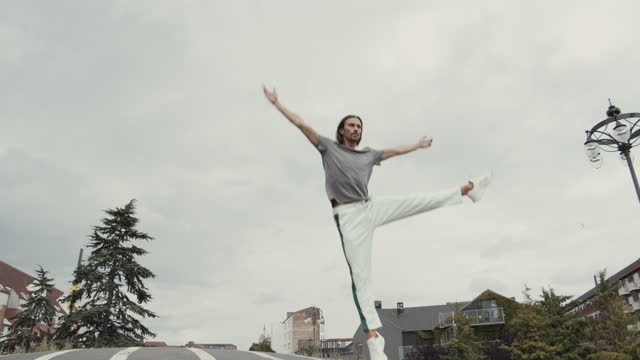 male dancer practicing ballet on road - shaky stock videos & royalty-free footage