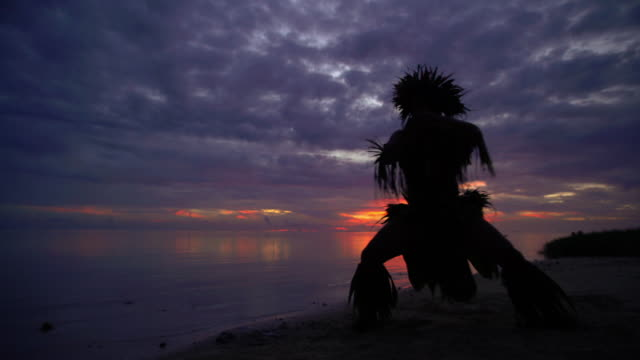 male dancing at sunset in traditional costume tahiti - tahitian culture stock videos & royalty-free footage