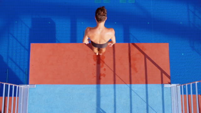 cs male diver stepping to the edge of the platform and preparing to jump - diving platform stock videos and b-roll footage