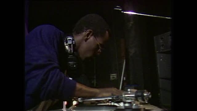 male dj scratches vinyl record on turntable; 1984 - game show bildbanksvideor och videomaterial från bakom kulisserna