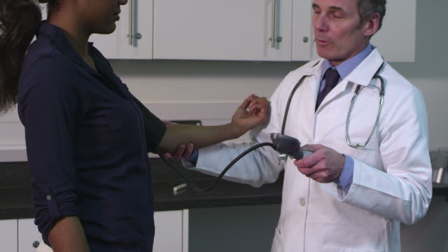 male doctor checking pulse trace to patient - 40 seconds or greater stock-videos und b-roll-filmmaterial