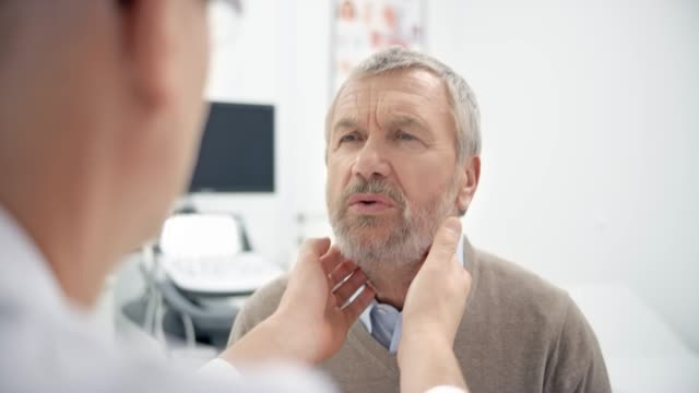 male doctor checking the patient's lymph nodes - lymph node stock videos & royalty-free footage