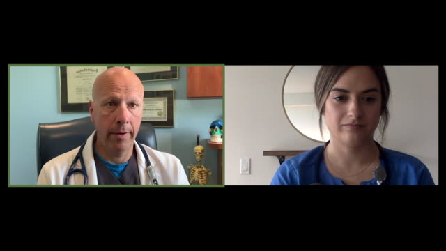 cu male doctor on video call with young female healthcare worker - completely bald stock videos & royalty-free footage