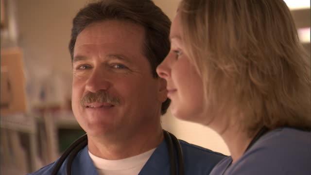 SLO MO, CU, R/F, Male doctor talking to female nurse