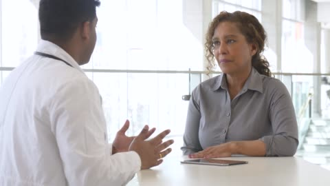 male doctor teaching his senior patient - patient stock videos & royalty-free footage