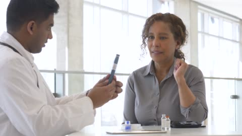 male doctor teaching his senior patient - syringe stock videos & royalty-free footage