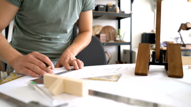 male drawing and working on a wooden product in his studio. anonymous footage. - drawing artistic product stock videos & royalty-free footage