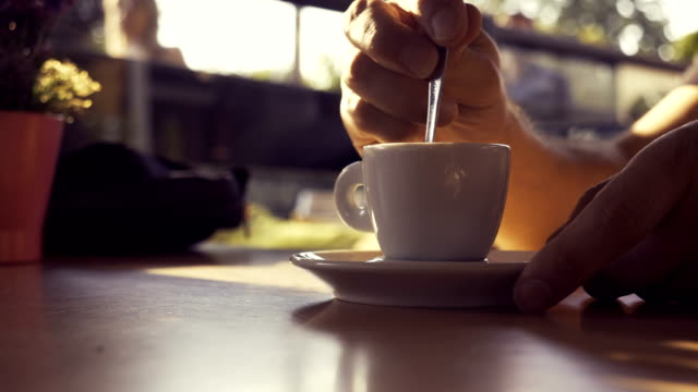 male drinking and stirring espresso - spoon stock videos & royalty-free footage