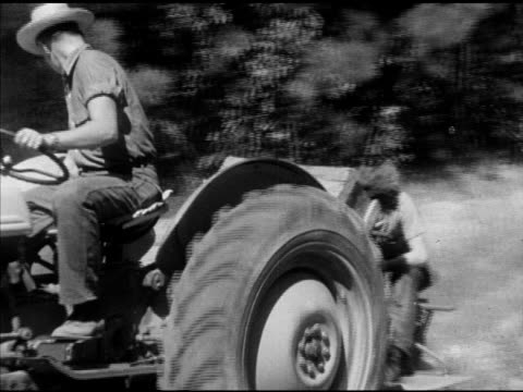 male driving tractor, laneburg h.s. student riding behind planting seeds . sowing, reforestation, reforesting, nevada county, arkansas, ar - 木材産業点の映像素材/bロール