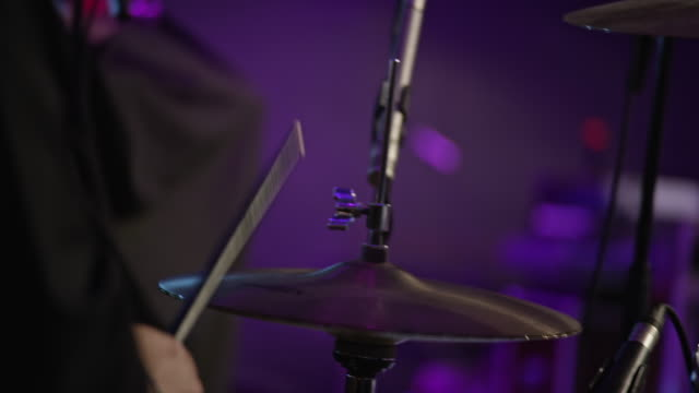 male drummer drumming on stage - cymbal stock videos and b-roll footage