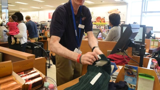 a male employee assists a customer with her purchases at the cash register of a kohl's clothing store in peoria illinois a womans pays for her... - kohls stock videos & royalty-free footage