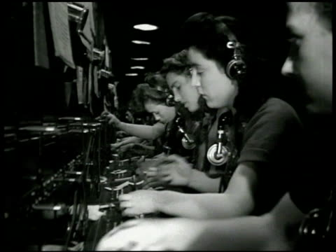telephone male engineers monitoring instruments ls line of female telephone operators working at switchboard cu london plug for overseas operator... - telephone switchboard stock videos and b-roll footage