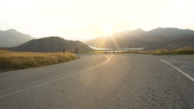 male enjoying biking mountain road lake wakatipu otago - aspirations stock videos & royalty-free footage