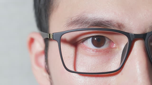 male eye wearing eyeglasses - lens eye stock videos & royalty-free footage