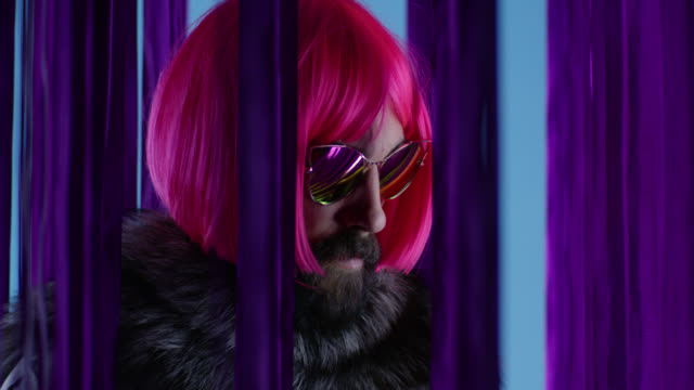 male fashion model in pink wig and sunglasses, wearing silver fox fur. fashion video. - drag queen stock videos and b-roll footage