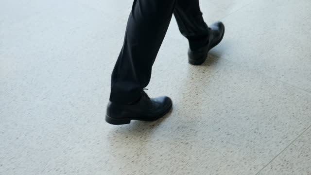 male feet of a businessman walking on the floor of the office - suit stock videos & royalty-free footage