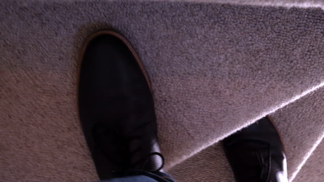 male feet walking upstairs. personal perspective. - staircase stock videos & royalty-free footage