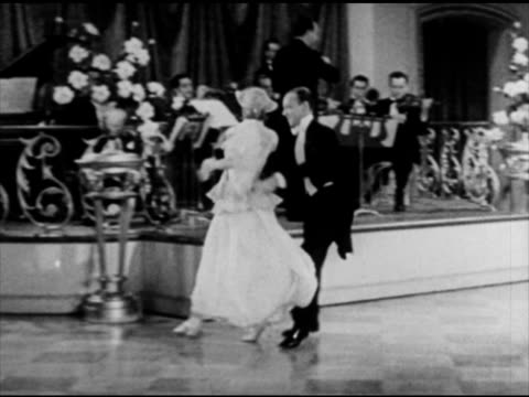 male female couple dancing in ballroom for audience dining at table - ballroom dancing stock videos & royalty-free footage