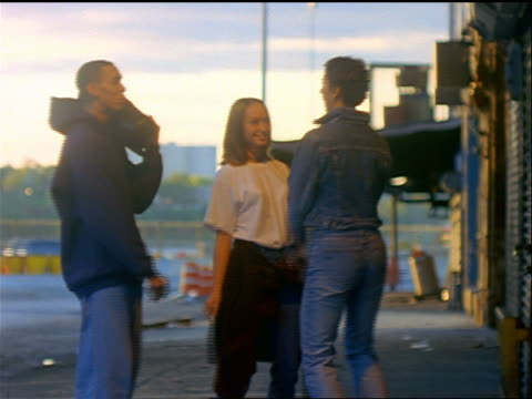 vidéos et rushes de 3 male + female teens (2 black) with stereo dancing on sidewalk in meat packing district / nyc - 1990 1999