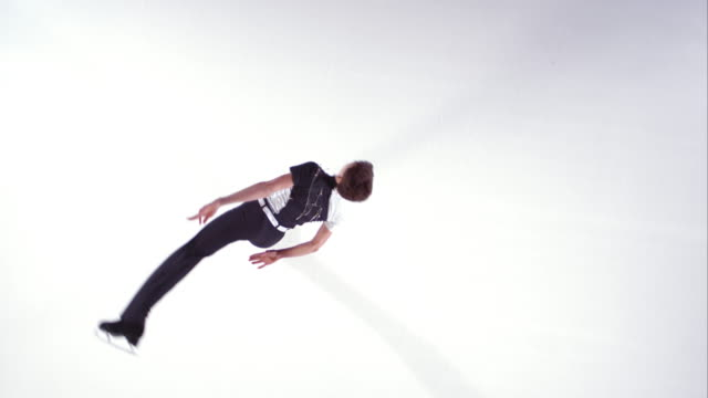 slo mo cs male figure skater performing a parallel spin - figure skating stock videos and b-roll footage