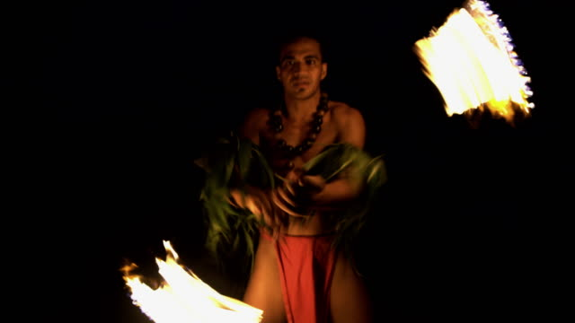 male fire dancer with flaming torch south pacific - tahitian culture stock videos & royalty-free footage
