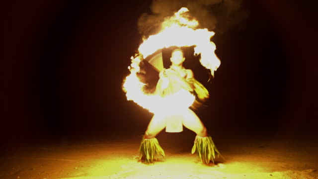 Male Fire dancer with flaming torch South Pacific