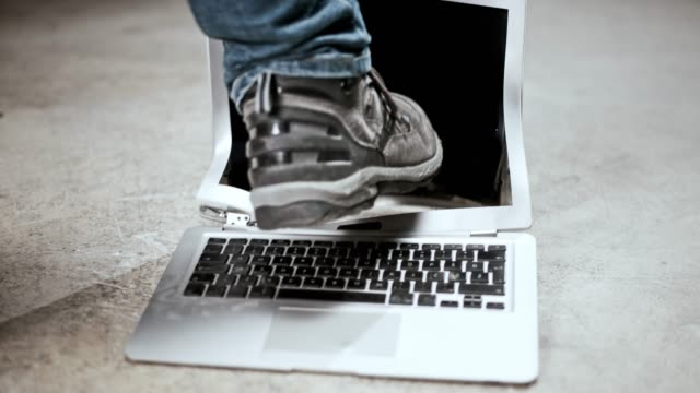 slo mo male foot kicking a laptop on the floor - breaking stock videos & royalty-free footage