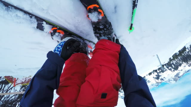 pov male freestyle skier buckling his snow boots - half pipe stock videos & royalty-free footage