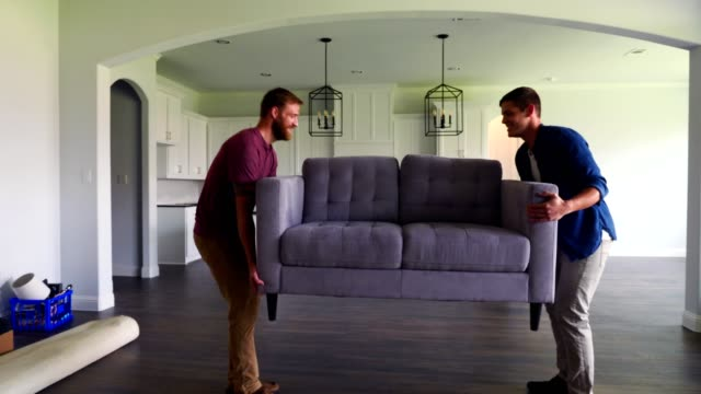 male friends carry sofa into new home - physical activity stock videos & royalty-free footage