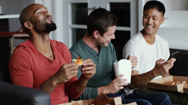 male friends eating different takeout meals together - friendship stock videos & royalty-free footage