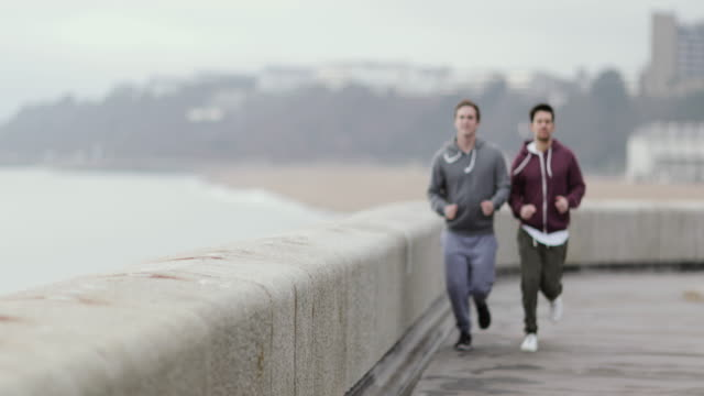 male friends jogging outdoors - only men stock videos & royalty-free footage