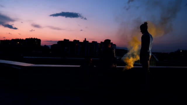 male friends on the roof of the building in sunset - male friendship stock videos and b-roll footage