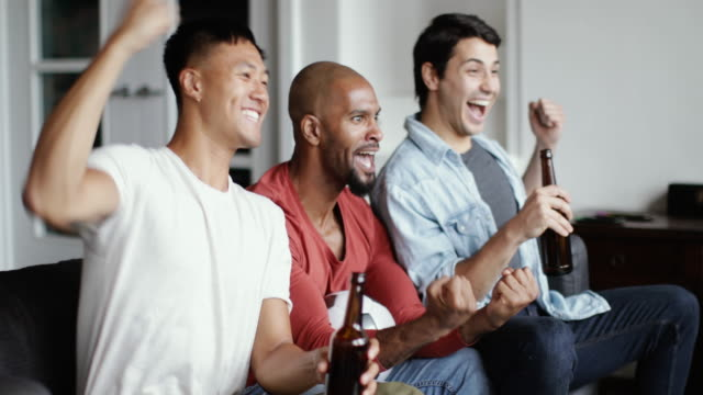 male friends watching a football match - fifa world cup stock videos & royalty-free footage