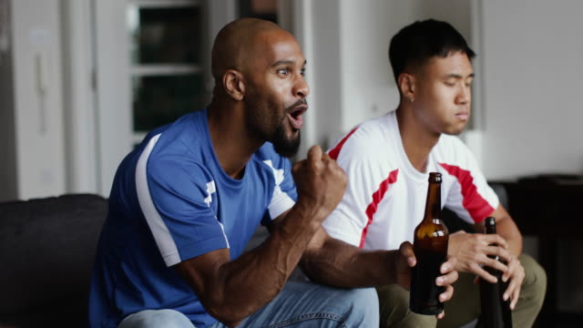 male friends watching a football match - fan enthusiast stock videos & royalty-free footage
