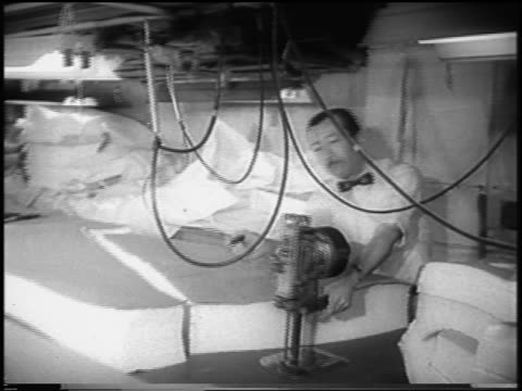 b/w 1958 male garment worker unplugs machinery removes apron / garment worker strike / newsreel - 1958 stock videos & royalty-free footage