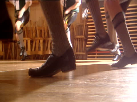 male german folk dancers in circle stamp their feet hard on the floor as they perform schuplatter bavaria - traditional clothing stock videos & royalty-free footage