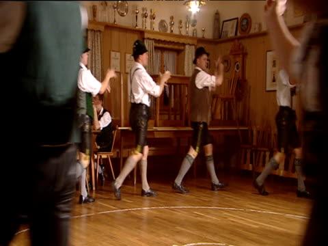 vidéos et rushes de male german folk dancers perform schuplatter bavaria - culture allemande