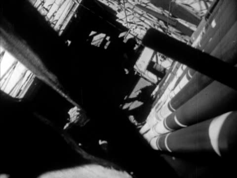 male gloved hands turning drill bit ha td workers at pipe below 'roughnecks' adjusting drill pipe w/ large clamp tu drill turning la ws worker... - drill bit stock videos and b-roll footage