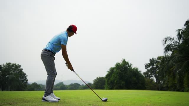 stockvideo's en b-roll-footage met mannelijke golfspeler op professionele golfcursus. - opteeën