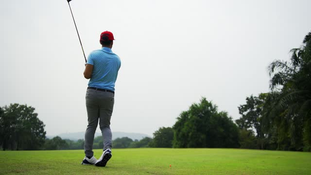male golf player on professional golf course. - golfer stock videos & royalty-free footage