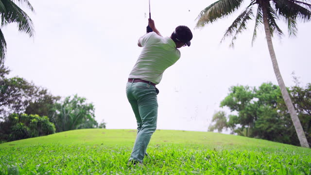 male golf player on professional golf course. - golf club stock videos & royalty-free footage
