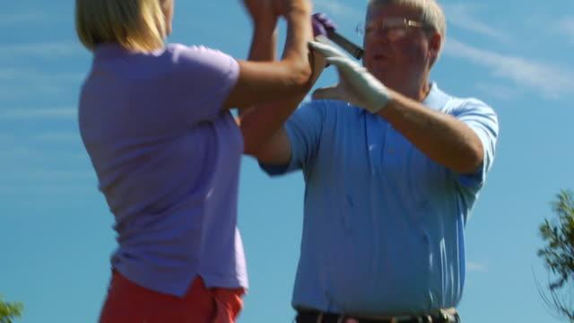 vídeos de stock e filmes b-roll de cu, tu, td, male golf trainer giving pointers to client, north truro, massachusetts, usa - golf
