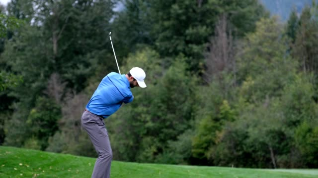 male golfer hits a great shot - golf course stock videos & royalty-free footage