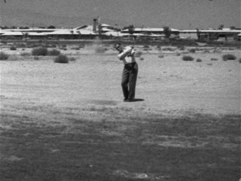 vidéos et rushes de male golfer hitting golf ball out of sand trap down frame walking down out of frame upscale upper class luxury leisure sport relaxing - 1952