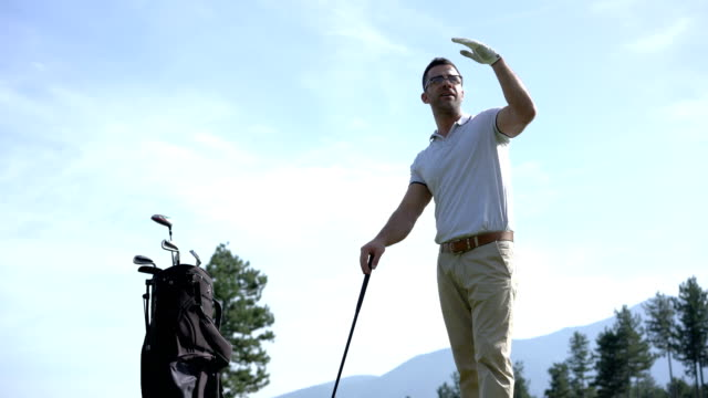 male golfer preparing for a tee shot on the golf course - golfer stock videos & royalty-free footage