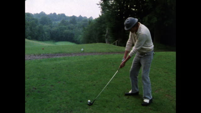 male golfer swings and hits golf ball on course; 1986 - taking a shot sport stock videos & royalty-free footage