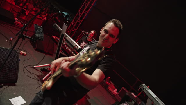 Male guitarist during concert on stage