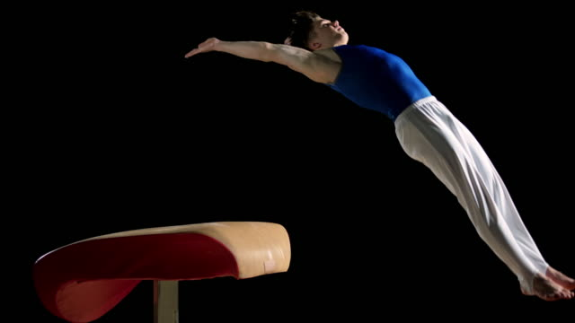 slo mo ds male gymnast doing a front handspring on the vault - gymnastics stock videos & royalty-free footage